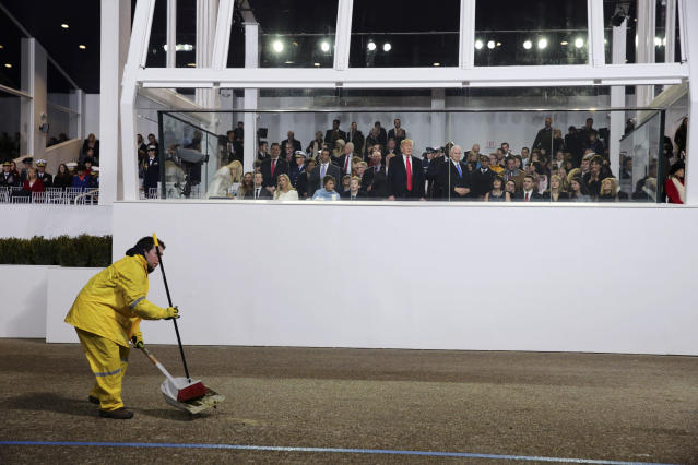 <p>An inaugural parade worker cleans up in front of President Donald Trump's viewing stand in Lafayette Park, near the White House in Washington, Jan. 20, 2017. (Photograph by Sam Hodgson/The New York Times) </p>