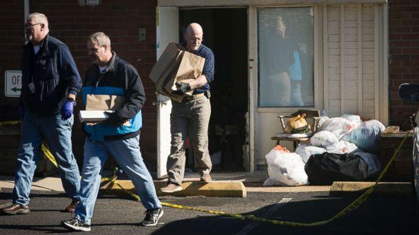PHOTO: Investigators carry out items from the Robert Morris Apartments in Morrisville, Pa., Feb. 26, 2019. (Matt Rourke/AP)