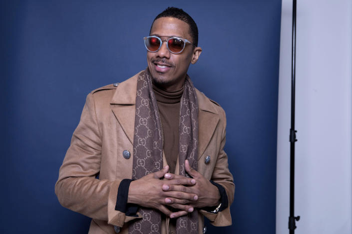 """FILE - In this Dec. 10, 2018, photo, Nick Cannon poses for a portrait in New York to promote promoting his new show, """"The Masked Singer."""" Cannon turns 40 on Oct. 8. (Photo by Amy Sussman/Invision/AP, File)"""