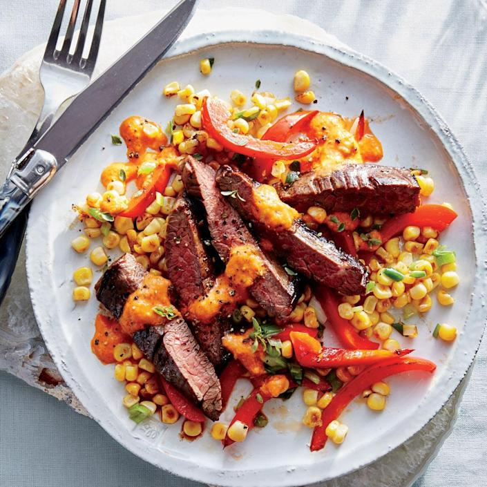 """<p>Red Bell Pepper gets used two tasty ways: as a vegetable in the corn sauté and as a pureed sauce for the plate. Fresh corn is not just sweet; it has a surprising hit of umami intensity.</p> <p><strong>Pantry Checklist</strong></p> <ul><li>Fish Sauce</li> <li>Red Bell Pepper</li> <li>Green Onions</li> <li>Skirt Steak</li> <li>Corn Kernels</li> </ul><p><strong>Hands-on:</strong> 30 minutes<br><strong>Total: </strong>1 hour, 30 minutes</p> <p> <a rel=""""nofollow noopener"""" href=""""http://www.myrecipes.com/recipe/skirt-steak-corn-red-pepper-puree"""" target=""""_blank"""" data-ylk=""""slk:View Recipe: Skirt Steak with Corn and Red Pepper Puree"""" class=""""link rapid-noclick-resp"""">View Recipe: Skirt Steak with Corn and Red Pepper Puree</a></p>"""
