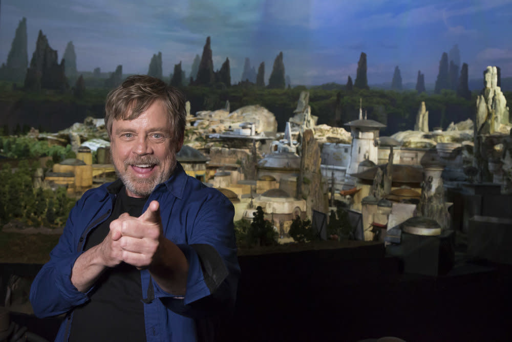 "<p>Mark Hamill was on hand to unveil the name of <a rel=""nofollow"" href=""https://www.yahoo.com/movies/disneys-star-wars-land-concept-slideshow-wp-022947702.html"">the new 14-acre land</a> during D23 Expo. (Joshua Sudock/Disney Parks) </p>"