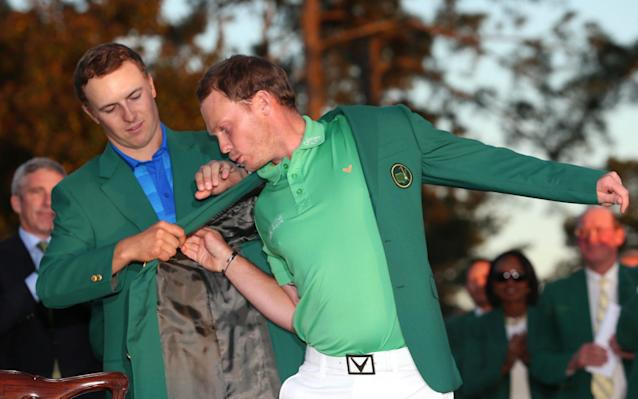 <span>Danny Willett is presented with the green jacket by Jordan Spieth last year</span> <span>Credit: Getty Images </span>