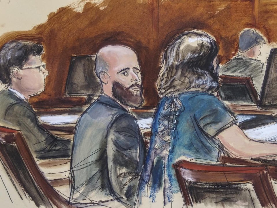 "In this Wednesday March 4, 2020 courtroom sketch Joshua Schulte, center, is seated at the defense table flanked by his attorneys during jury deliberations in New York. Joshua Schulte, a former CIA software engineer charged with leaking government secrets to WikiLeaks says it's cruel and unusual punishment that he's awaiting trial in solitary confinement, housed in a vermin-infested cell of a jail unit where inmates are treated like ""caged animals."" In court papers Tuesday, Jan. 19, 2021 Schulte maintained he is held in conditions ""below that of impoverished persons living in third world countries."" (Elizabeth Williams via AP)"