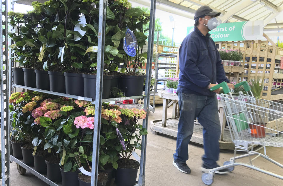A custiomer shops in a garden and DIY centre. Photo: Kirsty Wigglesworth/AP