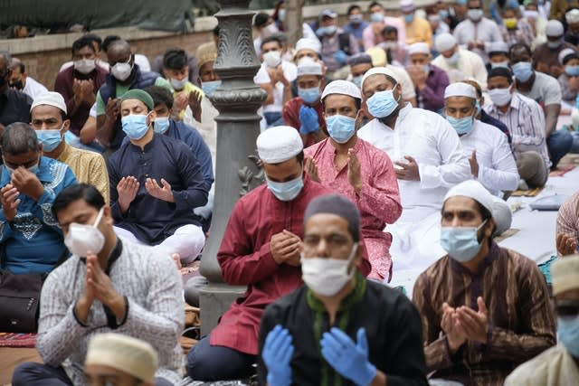 Muslims wore face masks while attending prayers for Eid al-Fitr in Rome's Piazza Vittorio Square