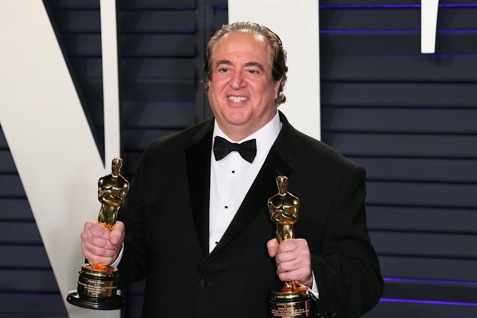 "Nick Vallelonga poses with the Oscars for Best Picture and Best Original Screenplay for ""Green Book"" at the 2019 Vanity Fair Oscar Party following the 91st Academy Awards. (Photo: JB LACROIX via Getty Images)"