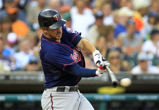Minnesota Twins' Trevor Plouffe hits a two-run single to left field during the fourth inning of a baseball game against the Detroit Tigers in Detroit, Monday, July 2, 2012. (AP Photo/Carlos Osorio)
