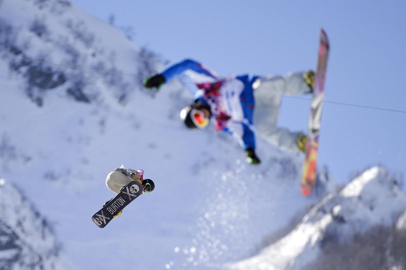 Shaun White, left, of the United States catches air during a training session for the men's snowboard halfpipe at the 2014 Winter Olympics, Saturday, Feb. 8, 2014, in Krasnaya Polyana, Russia. (AP Photo/Jae C. Hong)