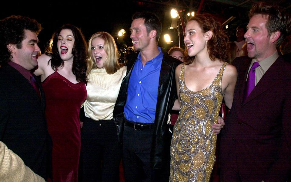 Cast of 'Book of Shadows Blair Witch 2' greet director, Joe Berlinger, left, before the premiere of the movie in Los Angeles, Monday, Oct. 23, 2000. The cast members are; Kim Director, second from left, Tristen Skyler, Jeff Donovan, Erica Leerhsen and Stephen Barker Turner. (AP Photo/Kim Johnson)