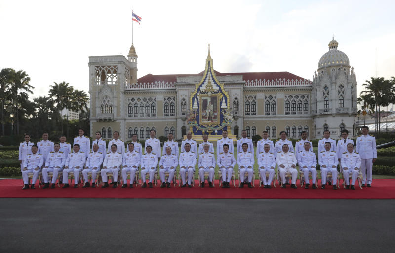 Thailand's Prime Minister Prayuth Chan-ocha, ninth from left in front row, and his cabinet members pose for a group photo at the government house in Bangkok Tuesday, July 16, 2019. Thailand's Prime Minister Prayuth Chan-ocha on Tuesday is leading his 36 cabinet members to take oath in front of Thailand's King Maha Vajiralongkorn. (AP Photo/Sakchai Lalit)