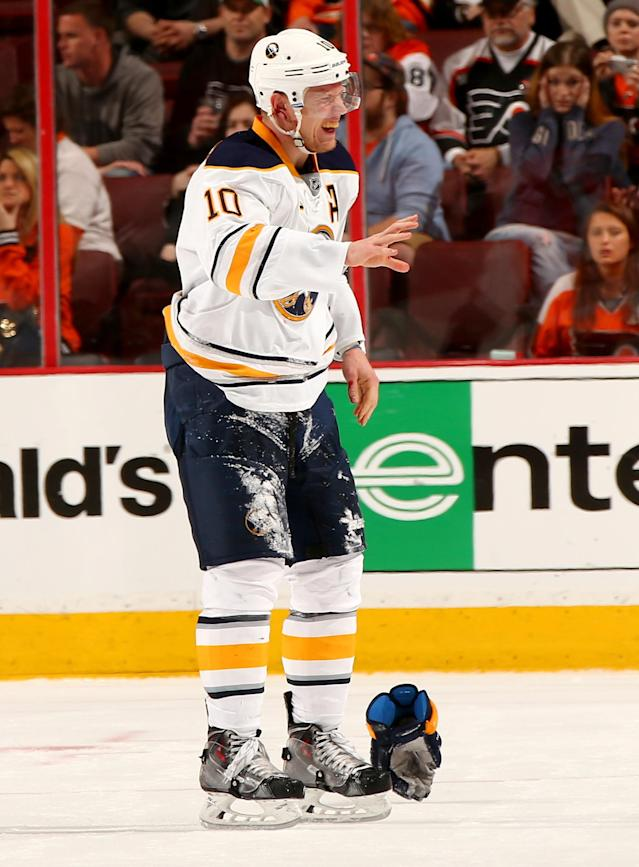 PHILADELPHIA, PA - APRIL 06: Christian Ehrhoff #10 of the Buffalo Sabres skates off the ice after his ear was cut in the third period against the Philadelphia Flyers at Wells Fargo Center on April 6, 2014 in Philadelphia, Pennsylvania.The Philadelphia Flyers defeated the Buffalo Sabres 5-2. (Photo by Elsa/Getty Images)