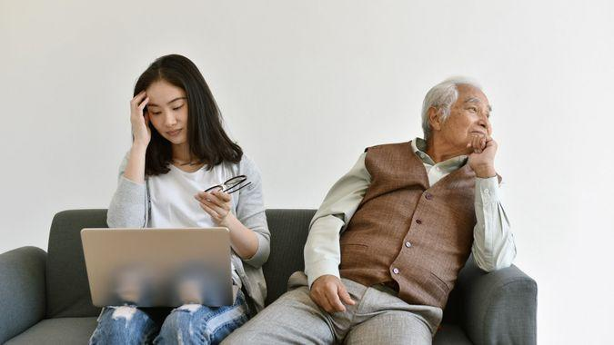 Social isolation problem in retiree citizen, Asian daughter focus on hard working and ignore loneliness elderly old father, Family relationship conflict, Senior mental health problem concept.
