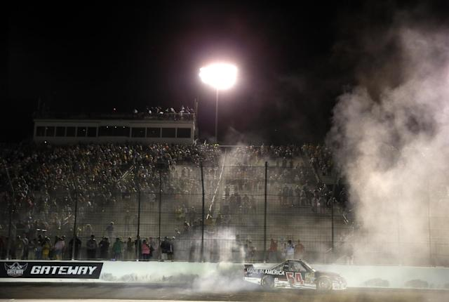 Darrell Wallace Jr. does a burnout after winning the NASCAR Truck Series auto race at Gateway Motorsports Park on Saturday, June 14, 2014, in Madison, Ill. (AP Photo/Jeff Roberson)