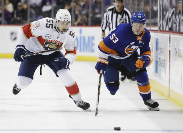 Florida Panthers' Bogdan Kiselevich (55) and New York Islanders' Casey Cizikas (53) skate for the puck during the second period of an NHL hockey game Wednesday, Oct. 24, 2018, in New York. (AP Photo/Frank Franklin II)
