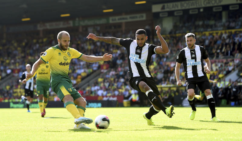 Norwich City's Teemu Pukki, left, has a shot on goal during the English Premier League soccer match between Norwich City and Newcastle United, at Carrow Road, in Norwich, England, Saturday, Aug.17, 2019. (Joe Giddens/PA via AP)