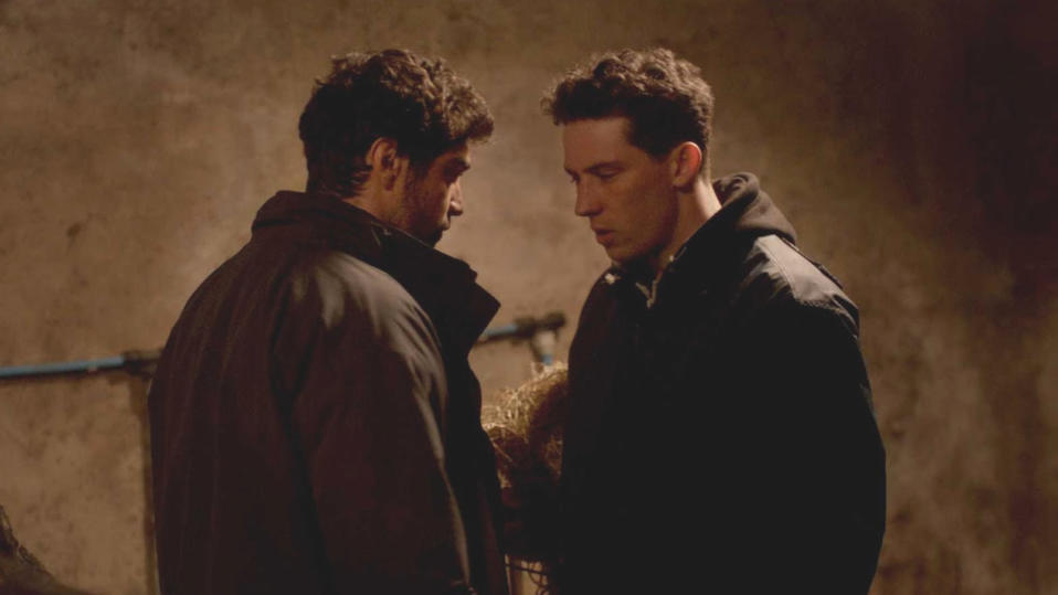 Alec Secăreanu and Josh O'Connor in 'God's Own Country'. (Credit: Picturehouse Entertainment)