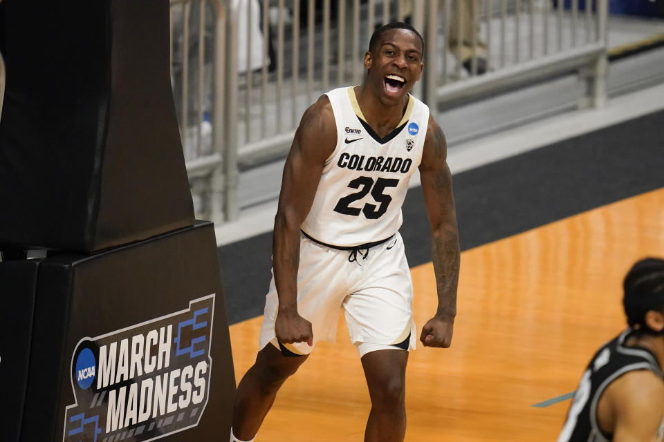 Colorado guard McKinley Wright IV (25) celebrates after a basket against Georgetown in the second half of a first-round game in the NCAA men's college basketball tournament at Hinkle Fieldhouse in Indianapolis, Saturday, March 20, 2021. Colorado defeated Georgetown 96-73. (AP Photo/Michael Conroy)