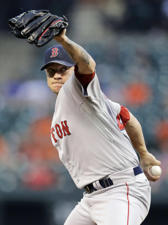 Boston Red Sox starting pitcher Jake Peavy throws to the Baltimore Orioles in the third inning of a baseball game, Monday, June 9, 2014, in Baltimore. (AP Photo/Patrick Semansky)
