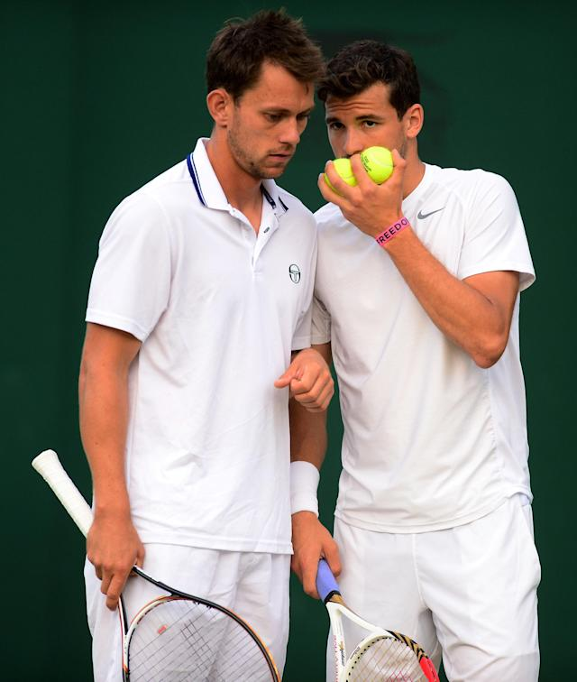 LONDON, ENGLAND - JUNE 29: Grigor Dimitrov of Bulgaria and Frederik Nielsen of Denmark talk tactics during their Gentlemen's Doubles second round match between Grigor Dimitrov of Bulgaria and Frederik Nielsen of Denmark and Julien Benneteau of France and Nenad Zimonjic of Serbia on day six of the Wimbledon Lawn Tennis Championships at the All England Lawn Tennis and Croquet Club on June 29, 2013 in London, England. (Photo by Mike Hewitt/Getty Images)
