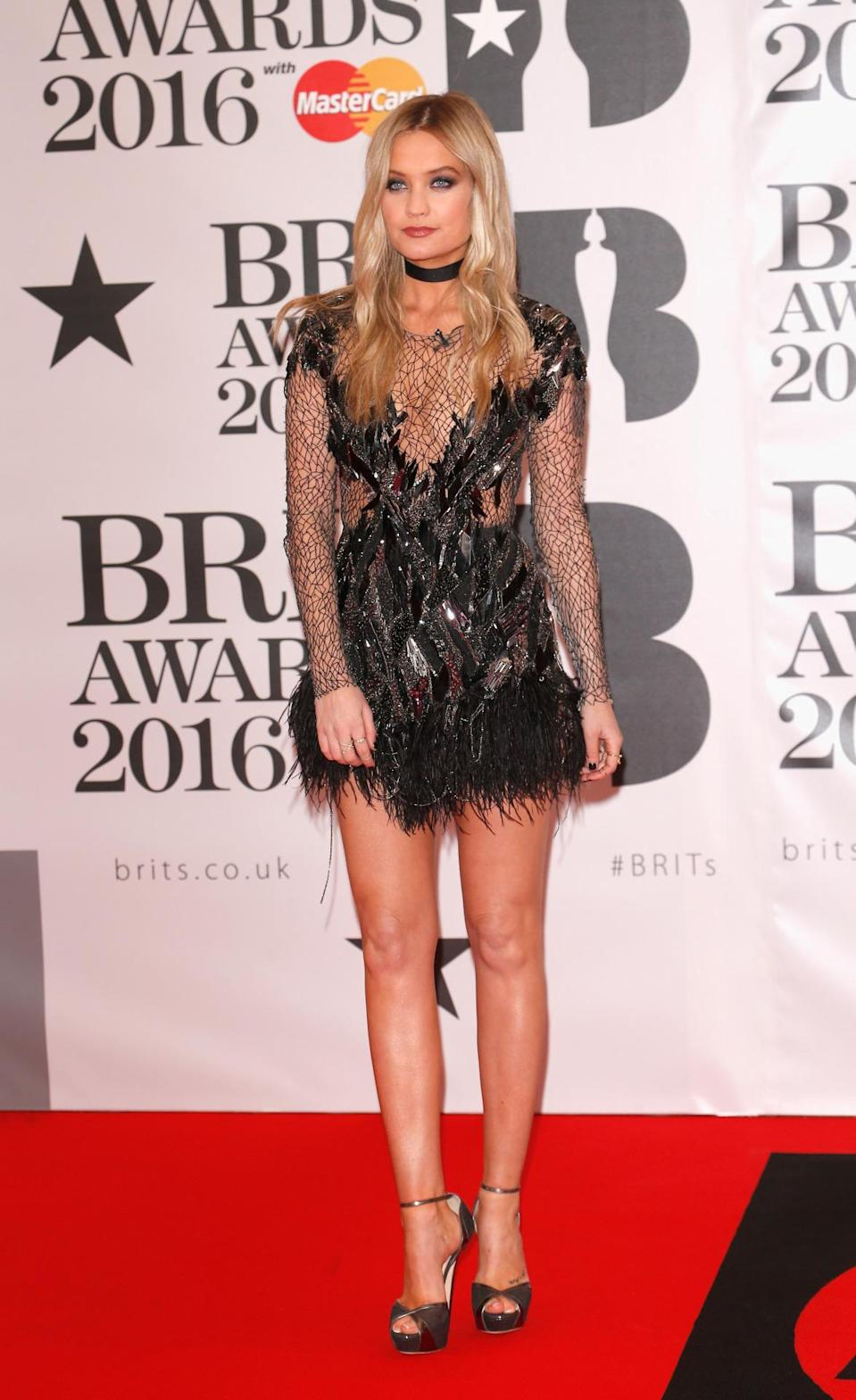 <p>Always the first to arrive (she turned up first at the BAFTA Awards last month), Laura Whitmore chose to show off her long legs in a feathered mini dress. <i>[Photo: Getty]</i></p>