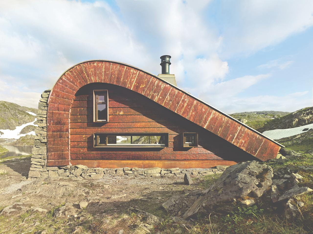Snøhetta helped a family realize their dream of building a cabin on a Norwegian mountain plateau where they take their sheep to graze each summer. <strong>Bjellandsbu Cabin</strong> was designed to blend in with the landscape but also sleep up to 21 people. The building's shape was chosen to mimic the terrain, and the structure is covered native grasses and stone.