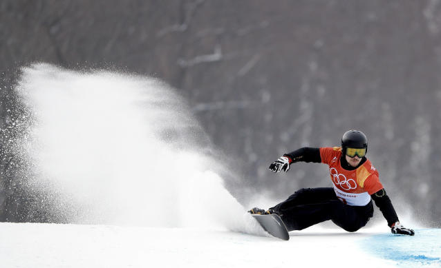 Russian athlete VicWild runs the course during the men's parallel giant slalom qualification run at Phoenix Snow Park at the 2018 Winter Olympics in Pyeongchang, South Korea, Saturday, Feb. 24, 2018. (AP Photo/Gregory Bull)