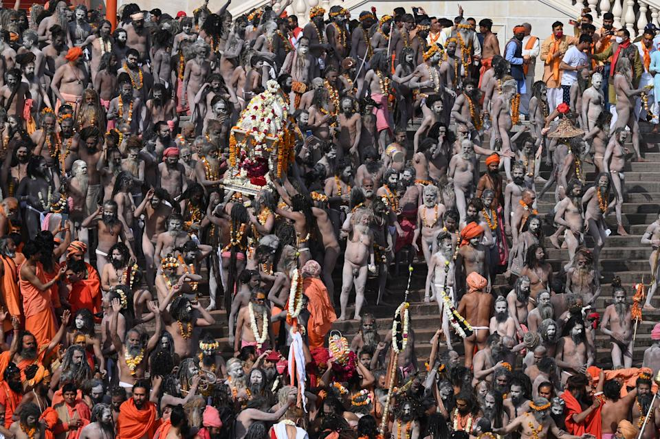 TOPSHOT - Naga Sadhus (Hindu holy men) gather before taking holy dip in the waters of the River Ganges on the Shahi snan (grand bath) on the occasion of Maha Shivratri festival during the ongoing religious Kumbh Mela festival in Haridwar on March 11, 2021. (Photo by Prakash SINGH / AFP) (Photo by PRAKASH SINGH/AFP via Getty Images)
