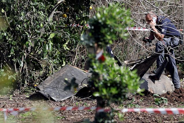 <p>An Israeli security personnel member speaks on his phone next to fragments of a Syrian anti-aircraft missile found in Alonei Abba about 2 miles (3.2 km) from where the remains of a crashed F-16 Israeli war plane were found in the village of Alonei Abba, Israel, Feb. 10, 2018. (Photo: Ronen Zvulun/Reuters) </p>