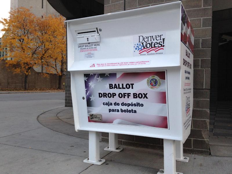 A ballot drop off box in Denver, CO, where early voting started on October 20, 2014. Republican Congressman Cory Gardner will be facing off with incumbent Democrat Mark Udall in the November 4, 2014 mid-term elections (AFP Photo/Ivan Couronne)