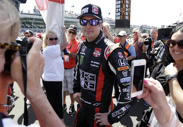 Kurt Busch is surrounded by fans as he stands on the starting grid before the start of the 98th running of the Indianapolis 500 IndyCar auto race at the Indianapolis Motor Speedway in Indianapolis, Sunday, May 25, 2014. (AP Photo/R Brent Smith)