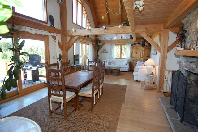 <p><span>4895 Arnold Rd., Golden, B.C.</span><br>The timber-frame house has four floors and unique features, such as this rock fireplace.<br>(Photo: Zoocasa) </p>