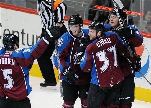 Colorado Avalanche center Ryan O'Reilly (37) celebrates his goal with teammates Shane O'Brien, left, Gabriel Landeskog, center left, and Erik Johnson, right, in the second period of an NHL hockey game on Friday, Dec. 23, 2011, in Denver. (AP Photo/Chris Schneider)