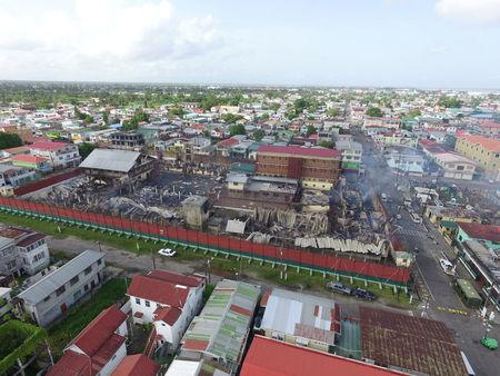 Armed inmates keep police at bay as fire destroys Guyana prison