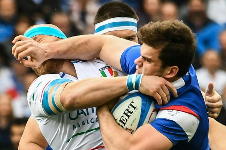 France's wing Damien Penaud (R) tackles Italy's hooker Leonardo Ghiraldini during the Six Nations in Rome