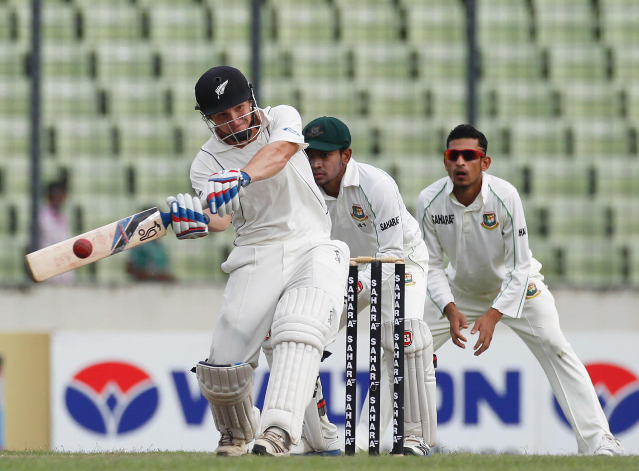 New Zealand's BJ Watling plays a shot against Bangladesh, during their third day of second test cricket match of the series in Dhaka October 23, 2013. REUTERS/Andrew Biraj (BANGLADESH - Tags: SPORT CRICKET)