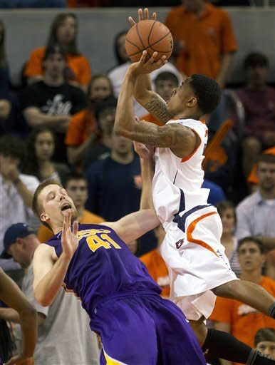 Auburn's Chris Denson, right, shoots over the defense of LSU's Justin Hamilton (41) during the first half of their NCAA college basketball game in Auburn, Ala., Saturday, March 3, 2012. (AP Photo/Dave Martin)