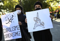 """Protesters hold placards with a depiction of Eiffel Tower in Paris, right, marked with a shoe stamp a sign of disrespect, and one, left, with a slogan reading in Turkish: """"""""Our resurrection, our resistance"""" , during a protest by members of Islamic groups against France in Istanbul, Sunday, Nov. 1, 2020. There had been tension between France and Turkey after Turkish President Recep Tayyip Erdogan said France's President Emmanuel Macron needed mental health treatment and made other comments that the French government described as unacceptably rude. Erdogan questioned his French counterpart's mental condition while criticizing Macron's attitude toward Islam and Muslims. (AP Photo)"""