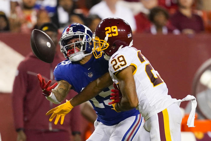 Washington Football Team cornerback Kendall Fuller (29) stops New York Giants wide receiver Kenny Golladay (19) from catching the ball during the second half of an NFL football game, Thursday, Sept. 16, 2021, in Landover, Md. (AP Photo/Alex Brandon)
