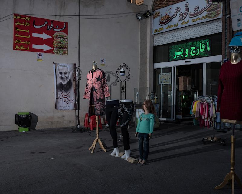 A poster of Soleimani hangs at a bazaar in the south of Tehran. | Newsha Tavakolian—Magnum Photos for TIME