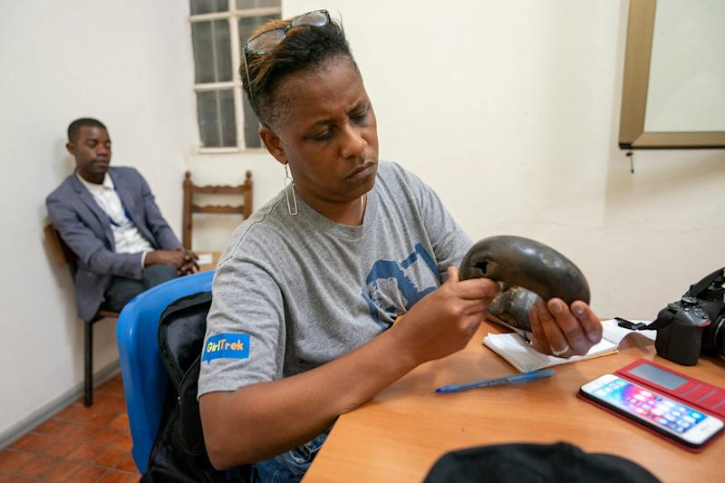 Deborah Barfield Berry looks at a 1,600-year-old ankle bracelet worn by women of royalty. She was part of a team from USA TODAY who visited this summer with Father Gabriele Bortolami, an Italian Capuchin priest and professor of anthropology at Agostinho Neto University in Luanda, Angola.