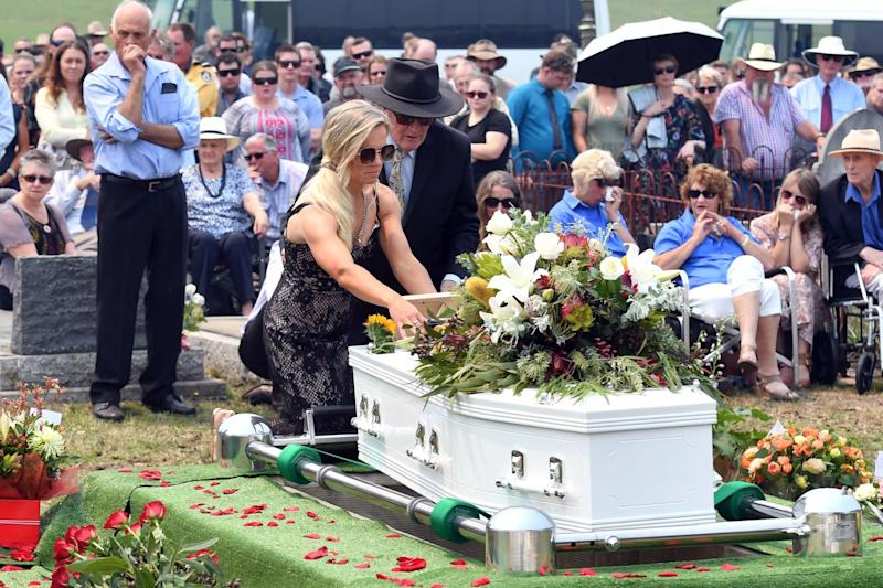 Raw grief: Renee Salway placing a photo on her husband Patrick's coffin: Getty Images
