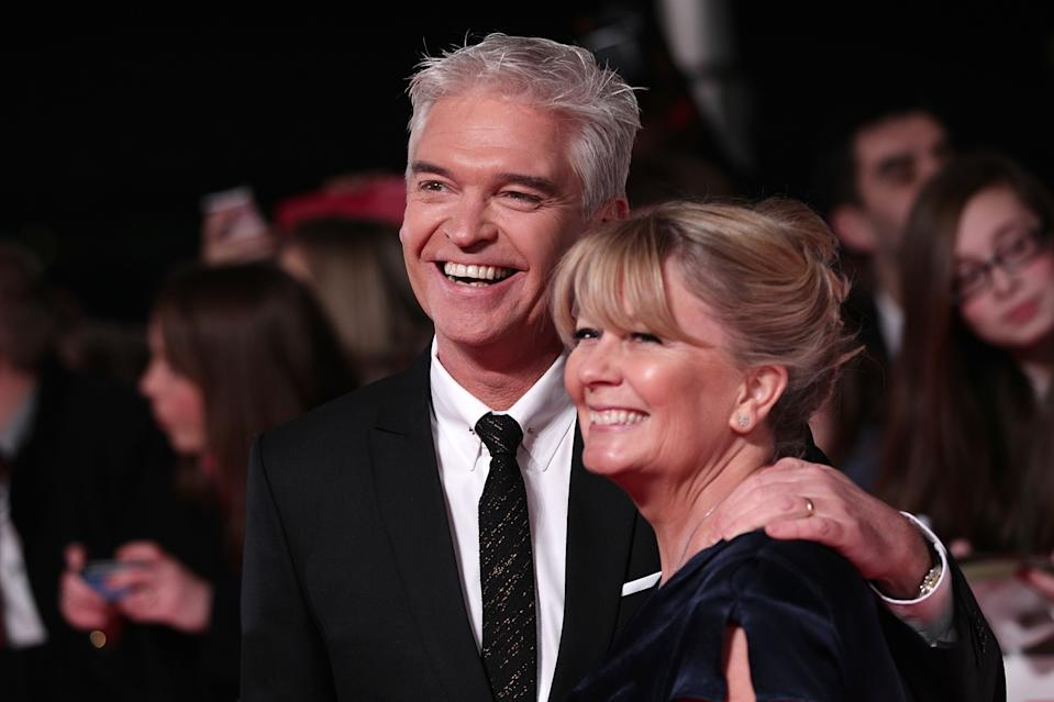 Philip Schofield and wife Stephanie arriving for the 2014 National Television Awards at the O2 Arena, London.   (Photo by Yui Mok/PA Images via Getty Images)