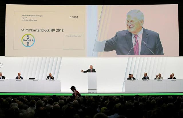 A Bayer Leverkusen's fan is seen in the audience as Werner Wenning, chairman of Bayer's supervisory board, speaks during the annual general shareholders meeting in Bonn, Germany, May 25, 2018. REUTERS/Wolfgang Rattay