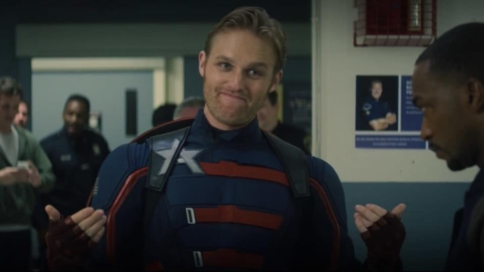 Wyatt Russell in his Captain America suit as Sam Wilson looks on in The Falcon and the Winter Soldier