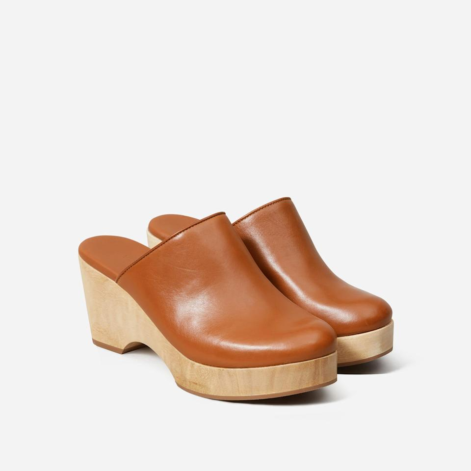 "<h2>Everlane Clog</h2><br>Everlane's classic twist on the wood-soled style needs no qualifier — it's simply ""The Clog."" Rendered with the brand's signature aesthetic restraint, the slip-on style is a steal at $98.<br><br><br><strong>Everlane</strong> The Clog, $, available at <a href=""https://go.skimresources.com/?id=30283X879131&url=https%3A%2F%2Fwww.everlane.com%2Fproducts%2Fwomens-clog-cognac%3Fcollection%3Dwomens-heels"" rel=""nofollow noopener"" target=""_blank"" data-ylk=""slk:Everlane"" class=""link rapid-noclick-resp"">Everlane</a>"