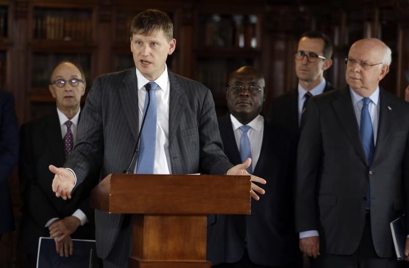British Ambassador Jonathan Guy speaks during a joint statement to reporters after a United Nations Security Council meeting in Bogota, Colombia, Friday, July 12, 2019. The U.N. council is in Colombia for a firsthand look at implementation of the 2016 peace agreement between the government and the country's main rebel group. (AP Photo/Fernando Vergara)