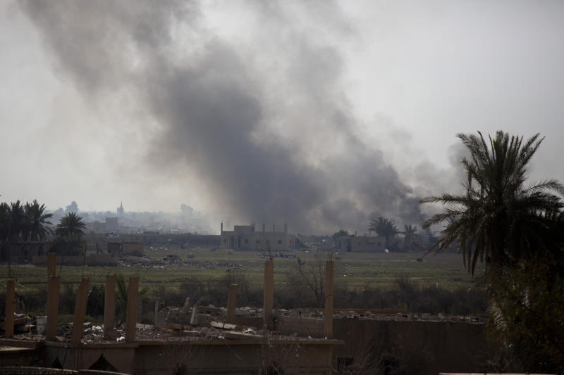 Smoke rises as U.S.-backed Syrian Democratic Forces (SDF) pound Baghouz, Syria with artillery and air strikes as the last pocket of Islamic State militants on Tuesday, March 12, 2019. (AP Photo/Maya Alleruzzo)