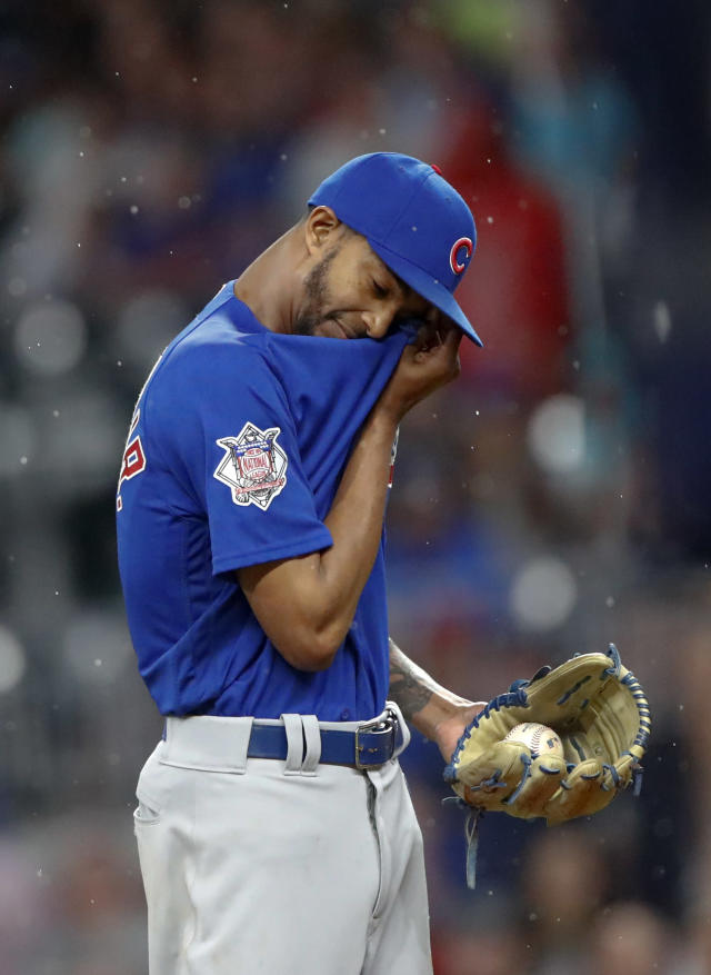 Chicago Cubs relief pitcher Carl Edwards Jr. dries his face between batters during the eighth inning of the team's baseball game against the Atlanta Braves on Wednesday, May 16, 2018, in Atlanta. The Braves won 4-1. (AP Photo/John Bazemore)