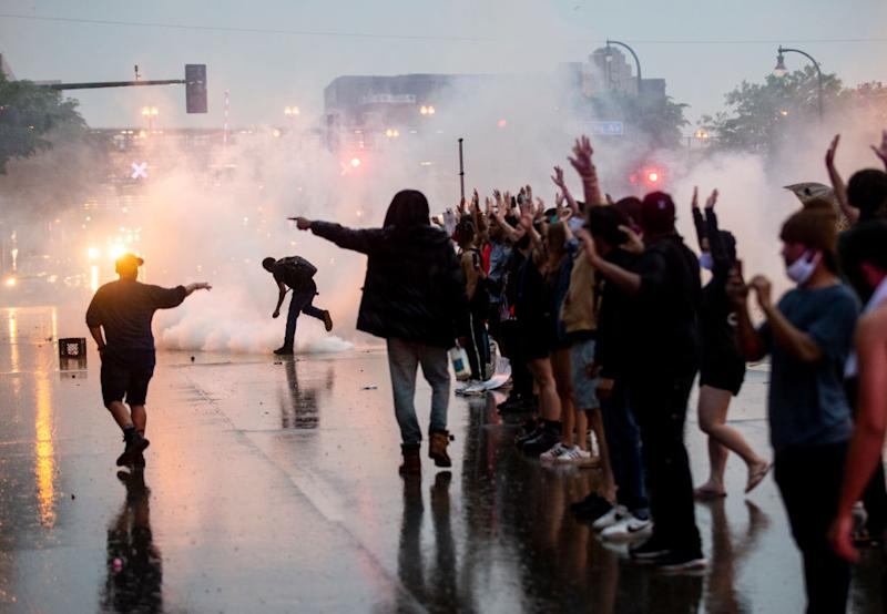 Tear gas is fired as protesters demonstrating against the death of George Floyd in Minneapolis. Source: Getty Images