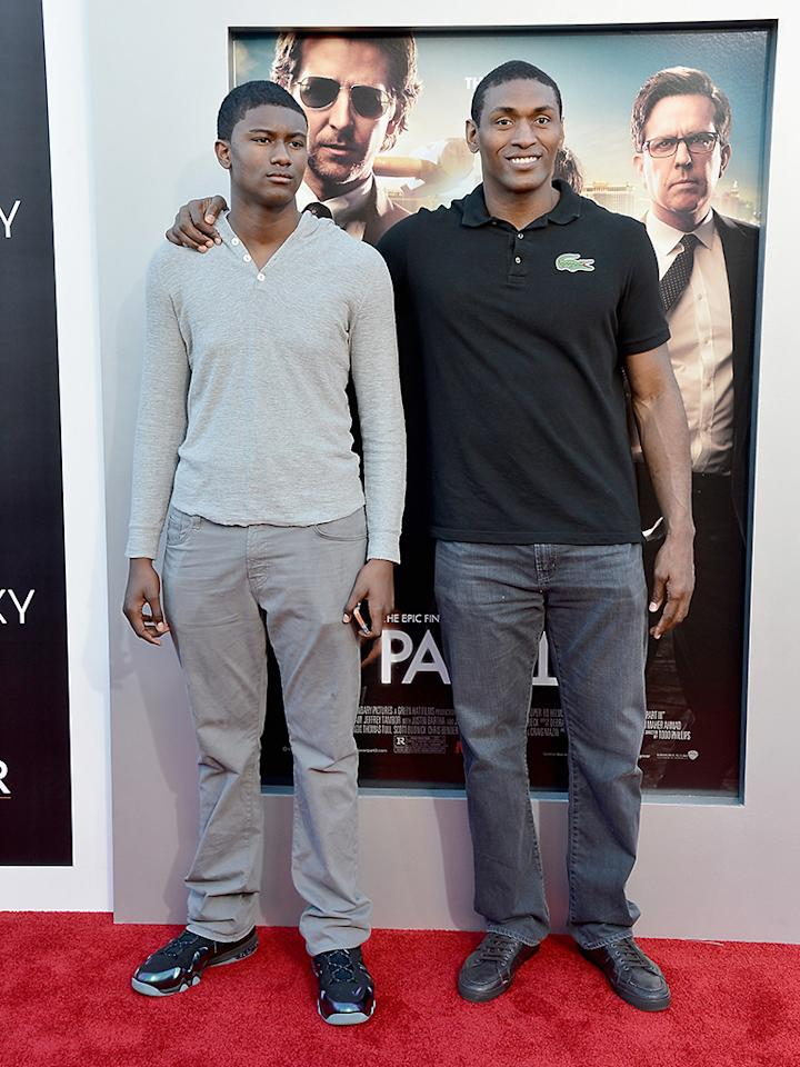 "WESTWOOD, CA - MAY 20:  NBA player Metta World Peace (R) and his son attend the premiere of Warner Bros. Pictures' ""Hangover Part 3"" at Westwood Village Theater on May 20, 2013 in Westwood, California.  (Photo by Frazer Harrison/Getty Images)"